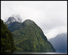 """Mitre Peak in Milford Sound<br /> <br /> Milford Sound is a fjord rather than a sound.  Sounds are formed by the action of rivers; fjords, by the action of glaciers.  Through a old misspelling of """"fjiord"""", the New Zealanders persist in calling this national park, Fiordlands.<br /> <br /> Milford Sound<br /> Fiordlands, NZ<br /> <br /> November 24, 2011"""