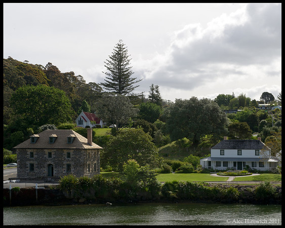Stone House (left) and Mission House (right) on the Kerikeri River<br /> <br /> The Stone House was built in 1832-1836 as a store house for the mission.  When the mission closed in 1848, it was leased to a succession of shopkeepers.<br /> <br /> Kerikeri, NZ<br /> November 18, 2011<br /> 060