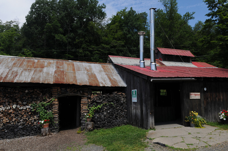 On the left is the wood shed, and on the right the sugar house where they boil the syrup