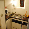 Ital0060 The kitchen is tiny, but is designed by the owners, who lived aboard a boat, to be like a ship's galley