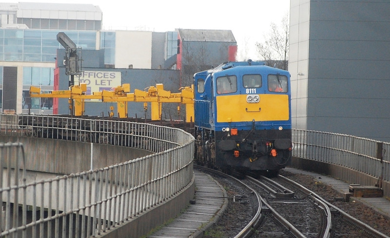 111 rounds the Dargan Bridge and into Yorkgate with the 1115 Adelaide Yard / Ballymena Transfer. 040411
