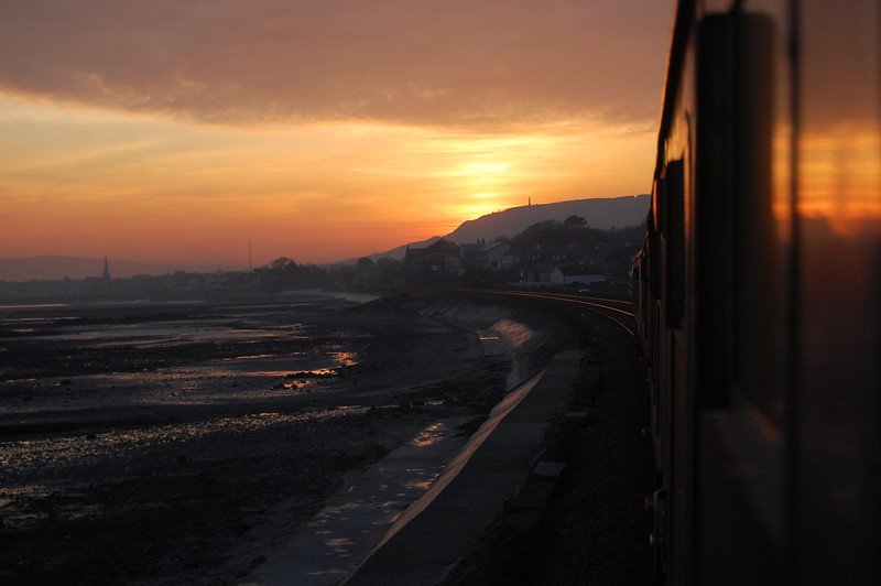 Sunset approaching Downshire with 90 & 94 with the 1715 from Larne Town. 030311