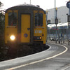 In a brief shower, 8786 leads the 1625 York Road/GVS empties into the terminus to form the 1648 to Carrickfergus 061011