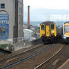 452 is seen departing Yorkgate on the 1312 Belfast Central/Carrickfergus while 3006 rounds the bend on the 1315 Fortwilliam/GVS  021011