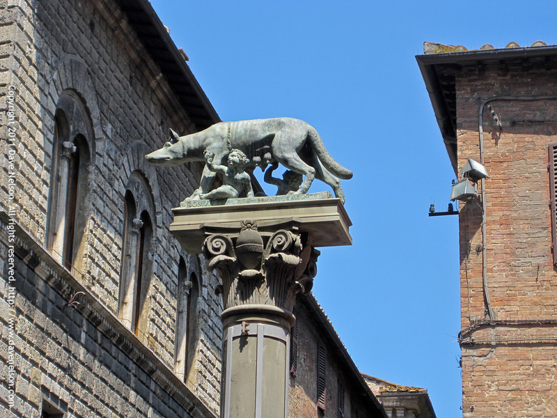 The town's emblem, a she-wolf suckling the infants Romulus and Remus. According to legend, Siena was founded by Senius, son of Remus, who was in turn the brother of Romulus, after whom Rome was named.