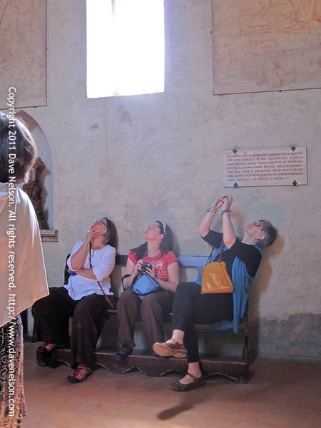 Looking at the frescos inside Montesiepi, San Galgano's hermitage