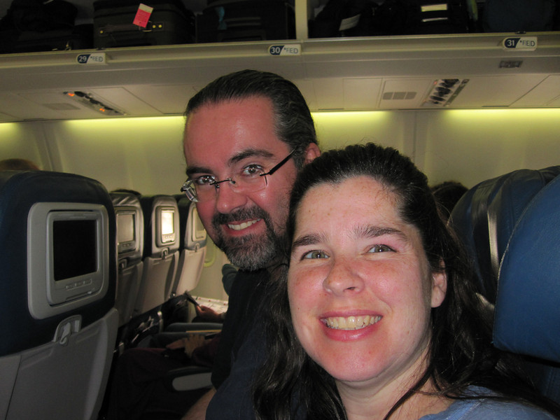 Bobbie and I on the plane headed to New York and then Italy.