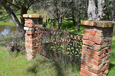 Iron gate that leads to the homestead cabin.