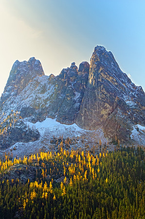 Liberty Bell Mountain with yellow Tamarack trees at its base.