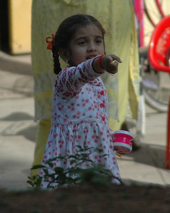 Girl points to monkey