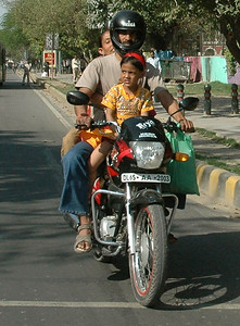 Family of four on a motor-scooter; New Delhi