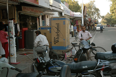 Man delivering appliances by bicycle cart, New Delhi