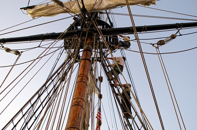 Crew member climbing the ropes on board the Lady Washington