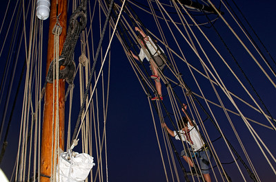 Decending the ropes after securing the sails for the evening.