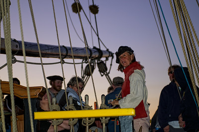 The first mate gives the orders to get the right ropes pulled and secured.