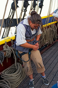 Crew members wear climbing harnesses when climbing the ropes of the Lady Washington