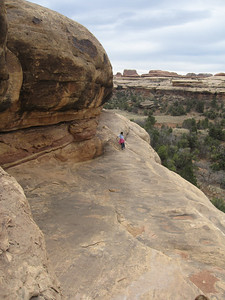 Kelly leads the way along the ledge
