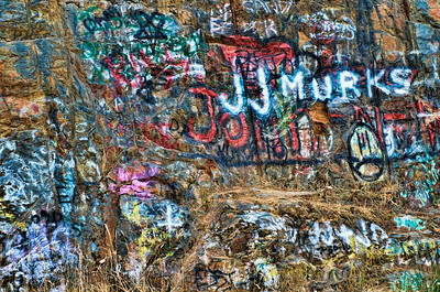 Crazy graffiti seen on a rock wall while driving to Mt Rainier
