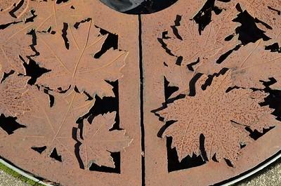 Iron grates around decorative trees along the streets of Raymond, WA.