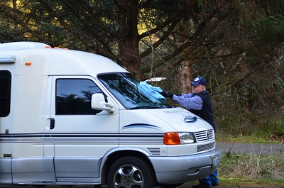 Dale washing Ramona's windshield.
