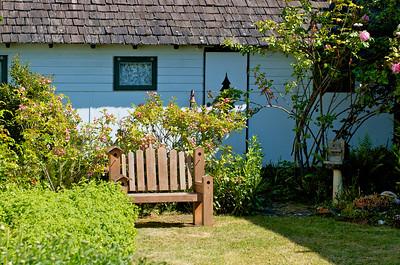 A cute bird house bench in a yard at Friday Harbor, WA