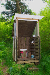 My brother's outhouse.  Made completely of recycled/free materials.  No need for a door because it looks into deep woods.