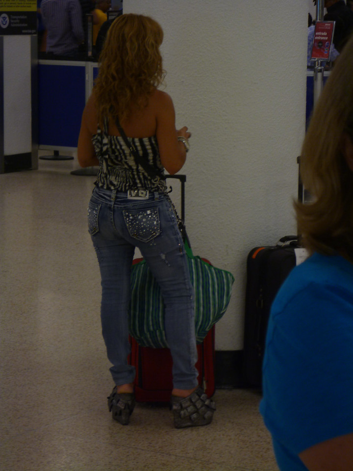 one word - shoes. ok, there are many words, but check out those shoes...Miami airport, of course