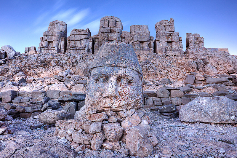 Eastern terrace of Nemrut Dagi at dawn<br /> <br /> The East face of Nemrut was extremely windy in early morning, and it was cold. There was already a group of tourists waiting to catch the sunrise when I got here.