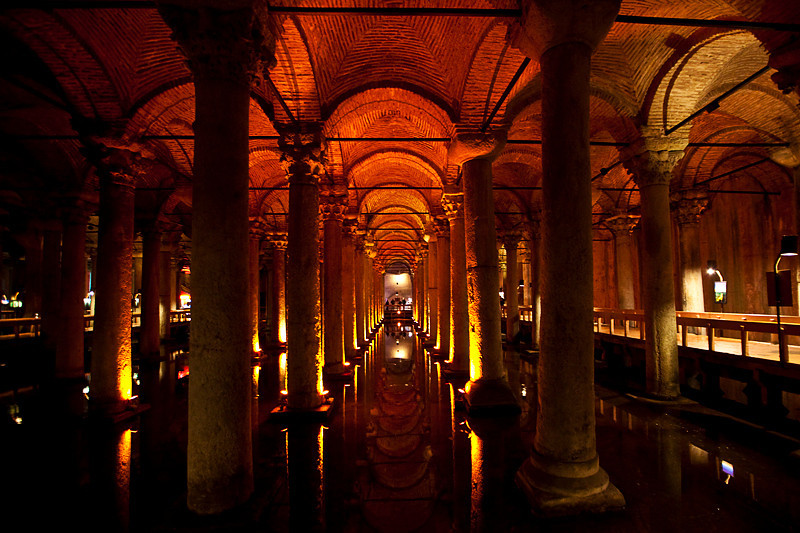 "Basilica Cistern, Istanbul<br /> <br /> The cistern was built by Emperor Justinian in 532 to store water for the Great Palace and surrounding buildings. From Lonely Planet: ""The cistern is 65m wide and 143m long, and its roof is supported by 336 columns arranged in 12 rows. It once held 80,000 cu metres of water, pumped and delivered through nearly 20km of aqueducts.""<br /> <br /> Operatic music plays over the loudspeakers in the cistern, and there are big black gold carps swimming in the shallow water below."