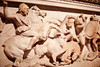 Istanbul Archaeology Museum<br /> <br /> Another depiction of Alexander the Great in battle on the Alexander Sarcophagus. In this carving, the Macedonian general is wearing a Nemean Lions head, the symbol of Hercules, as a headdress. His raised hand would've held some sort of spear or sword.