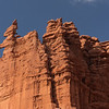 Some rock climbers precariously scaling to the very tip of on of the Fisher Towers