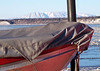 "Looking at Mt. Susitna, ""Sleeping Lady"", over the small boat lashed to the deck of the tugboat."