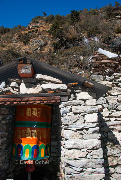 Note the waterfall above that (used to) feed(s) the prayer wheel.