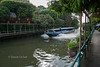 Khlong Saen Saeb. Note that the guys collecting money on the taxi boat wear helmets.