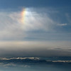 Rainbow in the air, above the clouds
