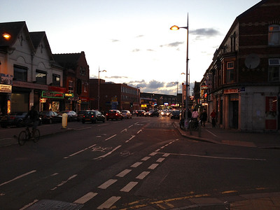 Rusholme district, Manchester: a long strip of Indian and middle-eastern restaurants, sweet shops, and hookah bars.