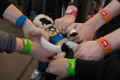 Great branding idea: Free slap bracelets for everyone to hype the new Muppet movie coming out on DVD/BluRay. Decent nostalgia play, etc. Unfortunately, the one size fits all slap bracelet didn't fit me, so Rally Monkey got a belt.