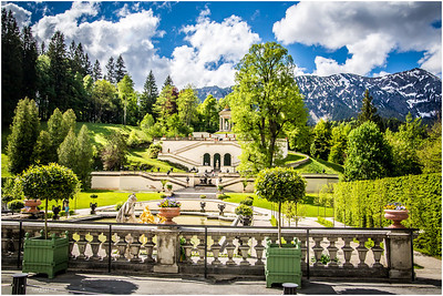 Set in seclusion, between a reflecting pool and the green slopes of a gentle mountain, Linderhof palace was used by King Ludwig II's father as a hunting retreat.