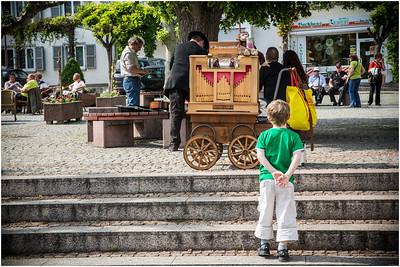 Boy ponders the vendor's ware
