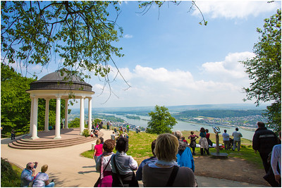 Tourists and locals congregate to soak in a sunny day and enjoy the beauty from this hilltop.