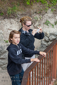 Tracey and Zack (looking annoyed) checking out Arch Rock.