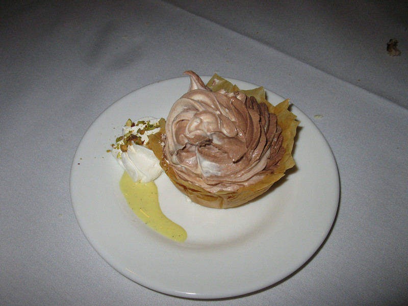 White and dark chocolate mousse in phyllo dough shell.  Yummy!