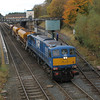112 passes Lisburn with 3 empty ballast hoppers running from Poyntzpass to Ballymena 291012