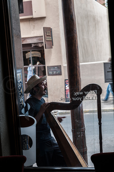 Harp playing Busker near the Plaza, Santa Fe.