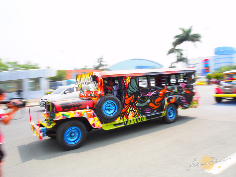 Panning one of the jeep as it rolls out of Mall of Asia