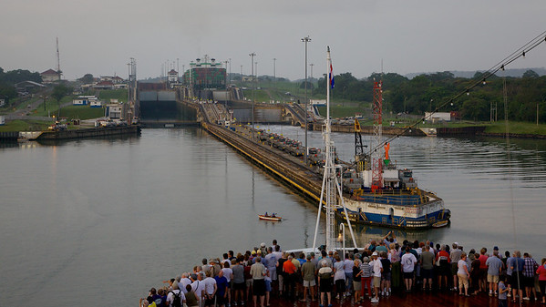 Statendam Approaching the First Lock (Gatun) in Panama, Rowboat is Bringing Tow Rope for Mules