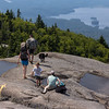 Hiking in the Adirondacks is a family affair. Children, babies, and dogs all apply. The three dogs at the peak happily splashed in the rain pools.