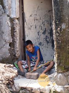 Kid by the door way