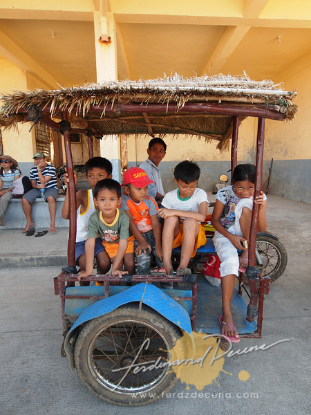 Sabtang Kids on a cogon-roofed Tricycle