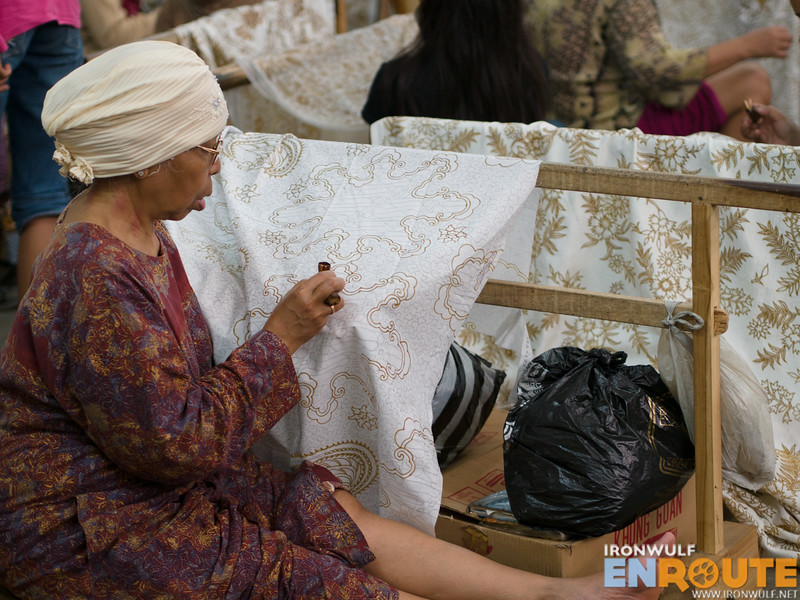 The fabric with designs are turned over for wax application